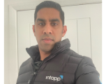 Intapp employee wearing Intapp branded winter coat