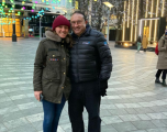 Intapp employee Xmas shopping with partner wearing Intapp branded winter jacket.