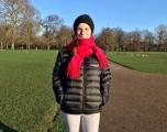 Intapp female employee out on a winter walk wearing Intapp branded jacket.