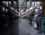 2 male Mitie security guards standing in the foyer of the Leadenhall Building
