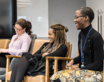 Three female Investec employees on the return to work panel discussion