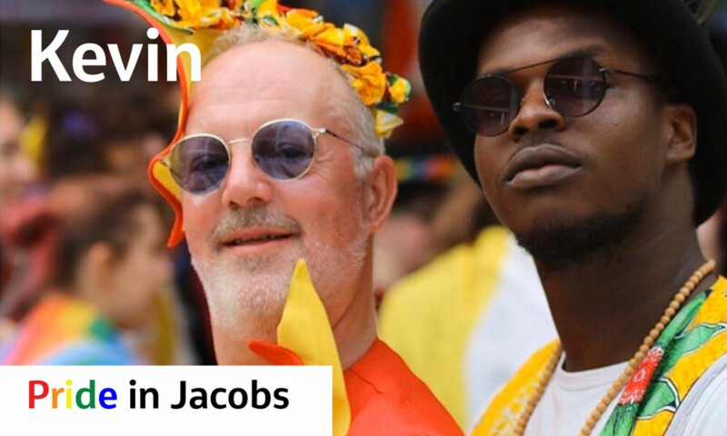 Image of a white man and a black man at Pride wearing sunglasses
