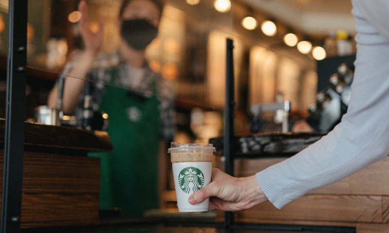 Customer receiving coffee
