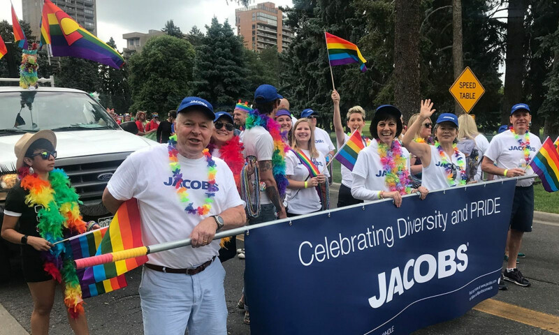 Group of smiling Jacobs employee's at a Pride march