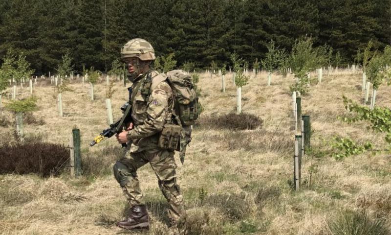 A Gurkha recruit from ITC Catterick moving across woodland plantation