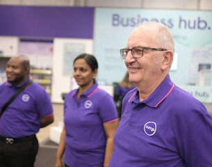 Three Currys store assistants, representing a broad range of ethnicity and age