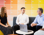 Three Currys staff meeting in an office surrounding