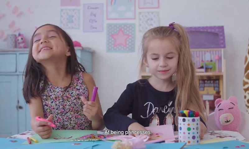 Two young girls saying what they think 'girls' are good at.