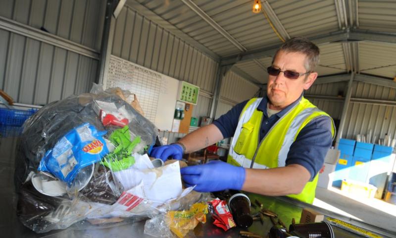 Man sorting refuse