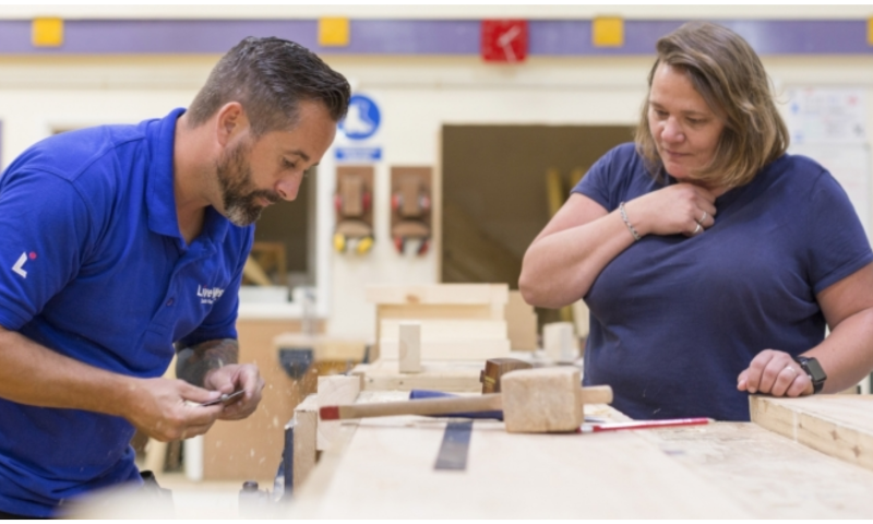 Woman taking part in practical woodwork session