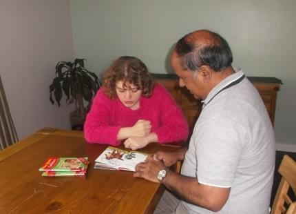 Image of Rewal Jagpal helping an autistic woman