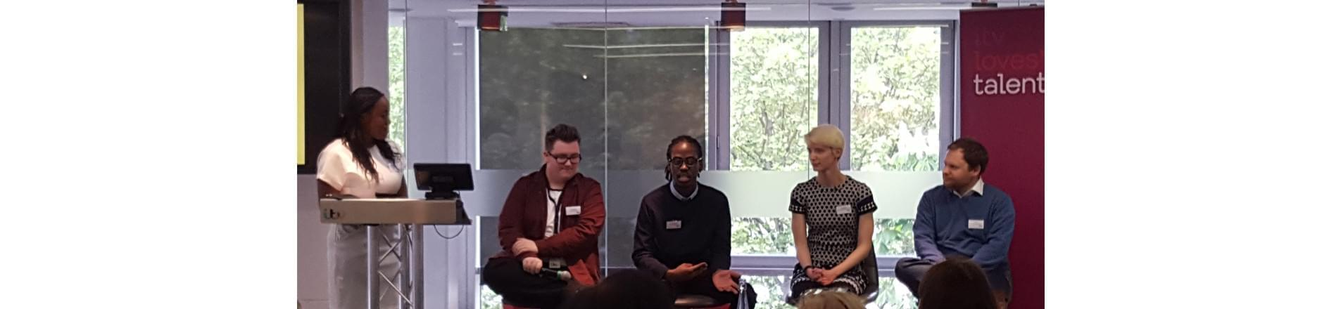 Lauren Mollyneaux-Brown talking at the event with the four panellists seated