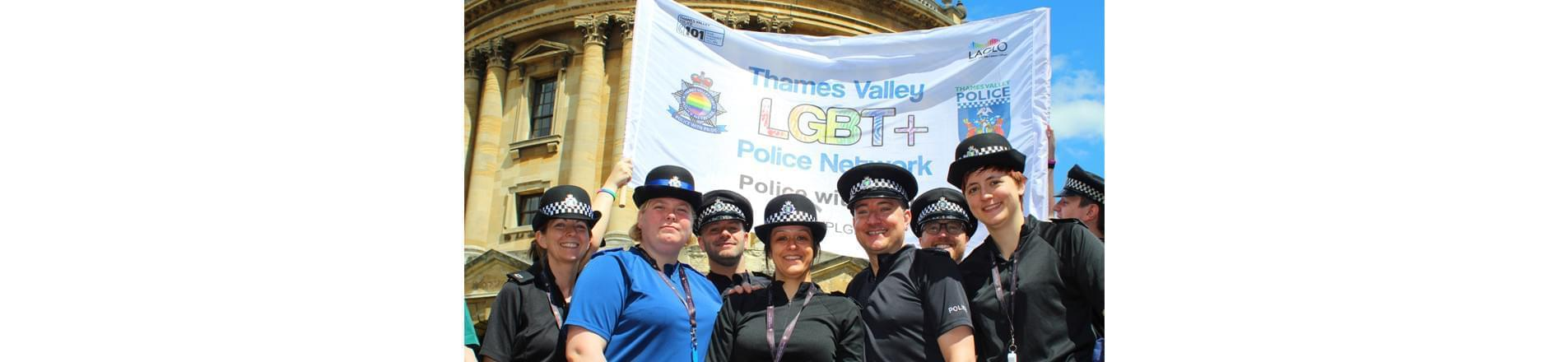 some Thames Valley Police employees at the 2017 Oxford Pride event with a banner promoting their LGBT+ Police Network