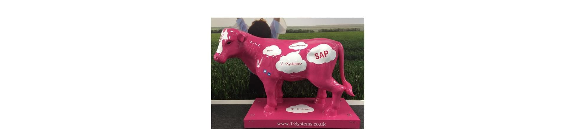 T-Systems' pink cow with speech bubbles saying IT Sec; Content Migration, T-Systems and SAP